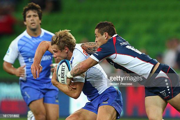 Kyle Godwin of the Force is tackled by Richard Kingi of the Rebels during the round one Super Rugby match between the Rebels and the Force at AAMI...