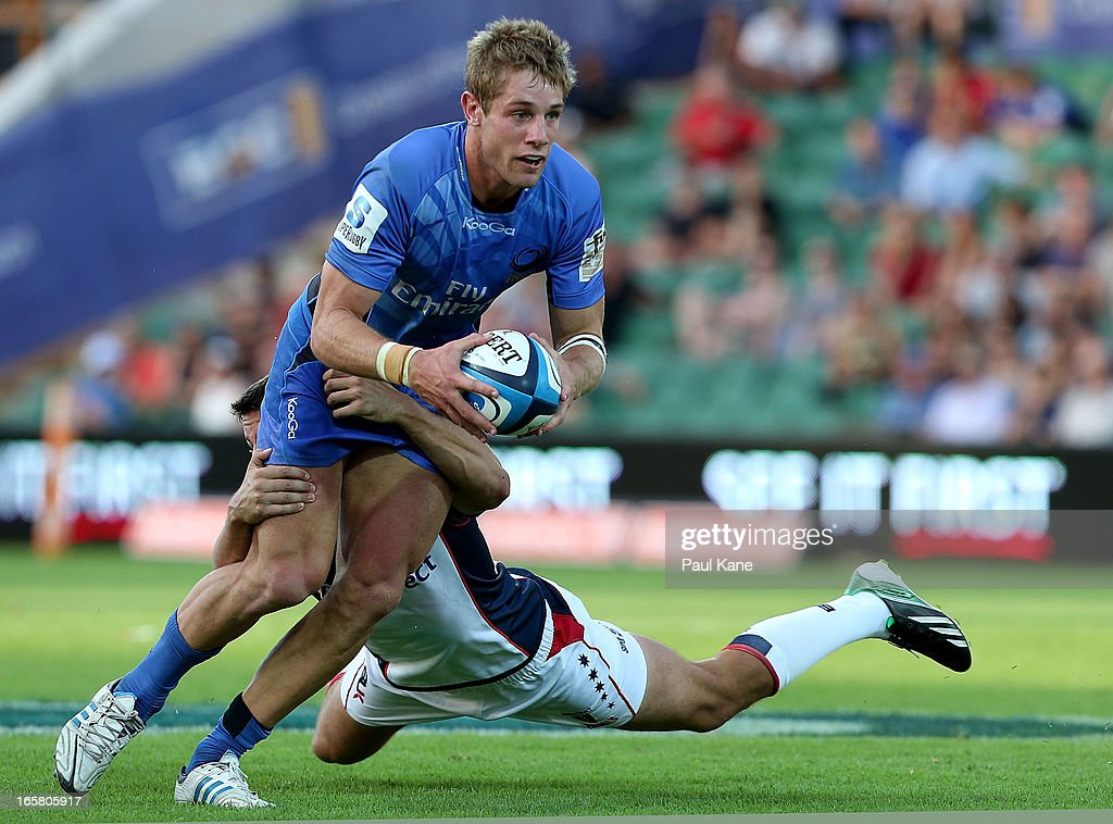 Kyle Godwin of the Force looks to avoid a tackle by Angus Roberts of the Rebels during the round eight Super Rugby match between the Western Force and the Melbourne Rebels at nib Stadium on April 6, 2013 in Perth, Australia.