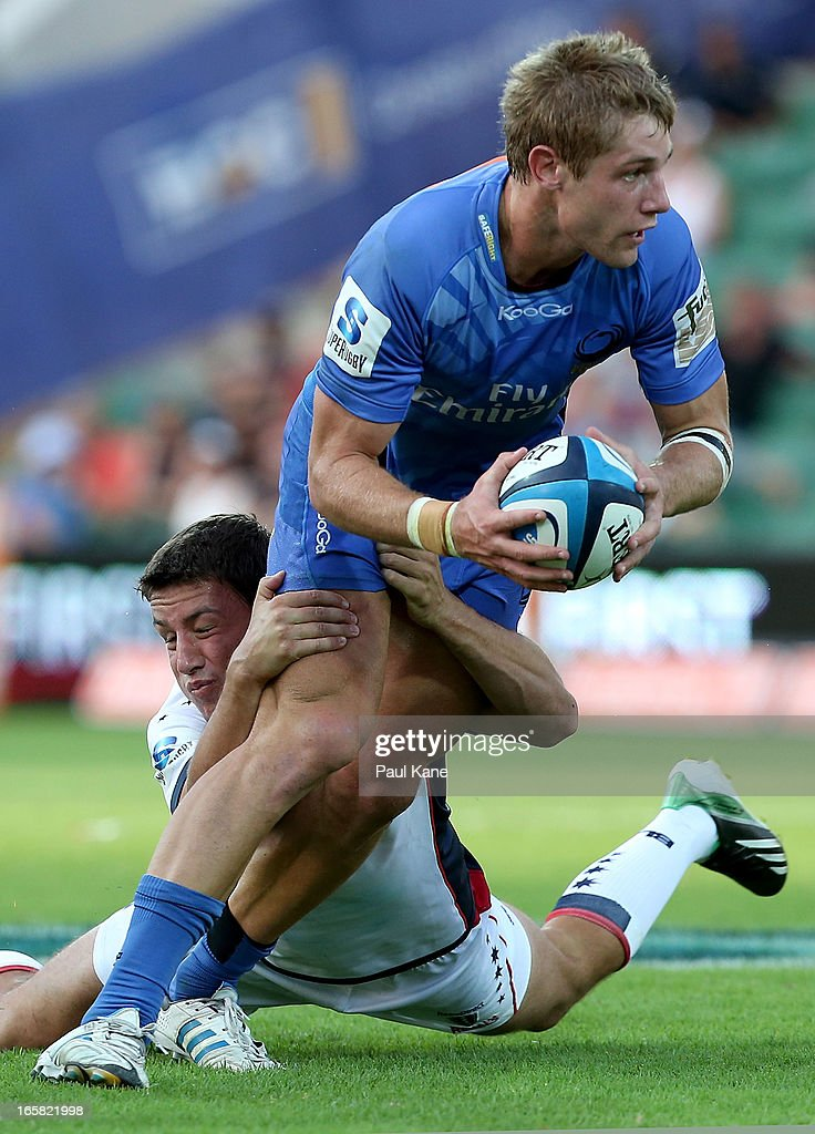 Kyle Godwin of the Force looks to break from a tackle by Angus Roberts of the Rebels during the round eight Super Rugby match between the Western Force and the Melbourne Rebels at nib Stadium on April 6, 2013 in Perth, Australia.