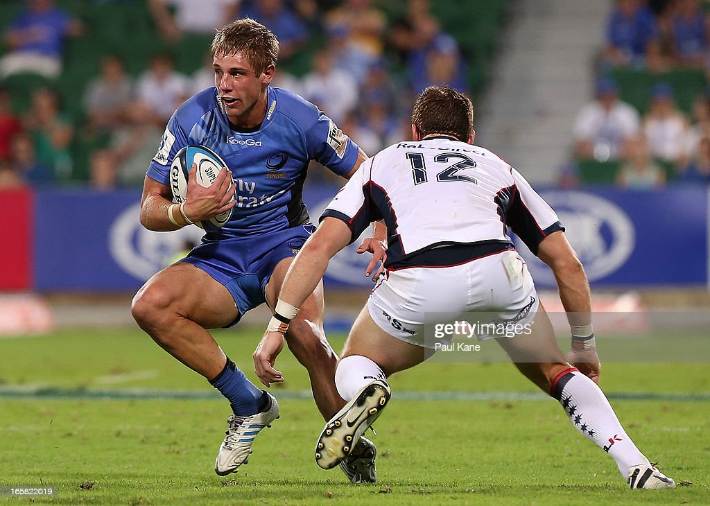 Kyle Godwin of the Force looks to evade a tackle by Rory Sidey of the Rebels during the round eight Super Rugby match between the Western Force and the Melbourne Rebels at nib Stadium on April 6, 2013 in Perth, Australia.