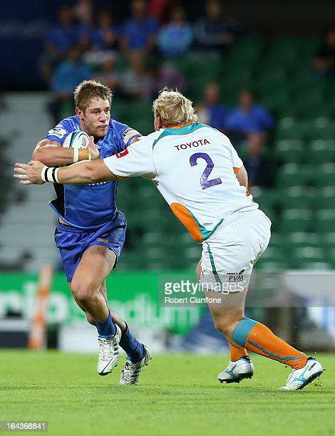 Kyle Godwin of the Western Force is challenged by Adriaan Strauss of the Cheetahs during the round six Super Rugby match between the Force and the...