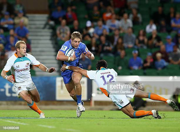 Kyle Godwin of the Western Force is challenged by Robert Ebersohn of the Cheetahs during the round six Super Rugby match between the Force and the...