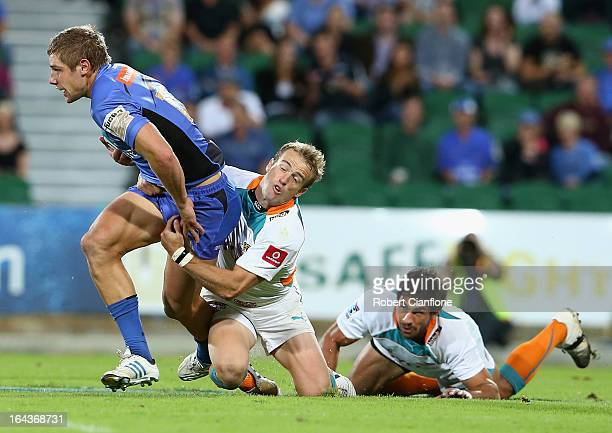 Kyle Godwin of the Western Force is tackled during the round six Super Rugby match between the Force and the Cheetahs at nib Stadium on March 23 2013...