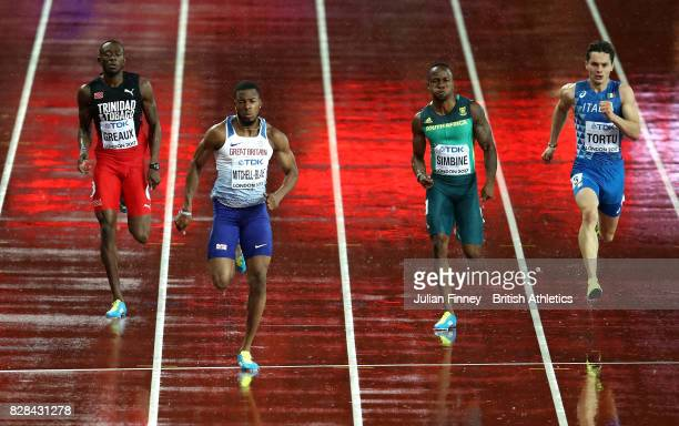 Kyle Greaux of Trinidad and Tobago Nethaneel MitchellBlake of Great Britain Akani Simbine of South Africa and Filippo Tortu of Italy compete in the...