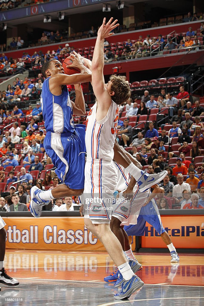 Kyle Green #25 of the Air Force Falcons goes to the net against Erik Murphy #33 of the Florida Gators at the MetroPCS Orange Bowl Basketball Classic on December 29, 2012 at the BB&T Center in Sunrise, Florida. The Gators defeated the Falcons 78-61.