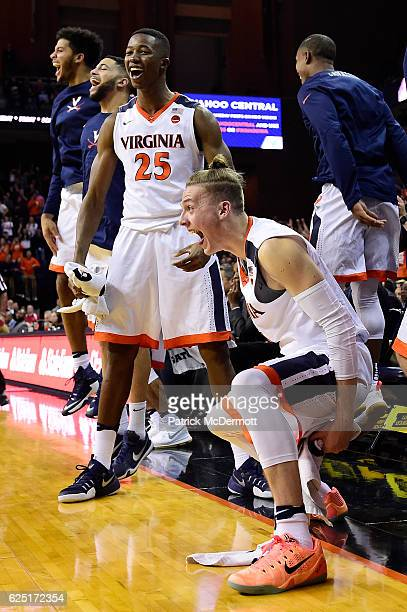 Kyle Guy and Mamadi Diakite of the Virginia Cavaliers celebrate after a basket in the second half during a game against the Grambling State Tigers at...
