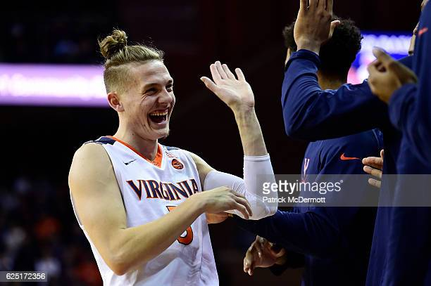 Kyle Guy of the Virginia Cavaliers celebrates with his teammates in the second half during a game against the Grambling State Tigers at John Paul...