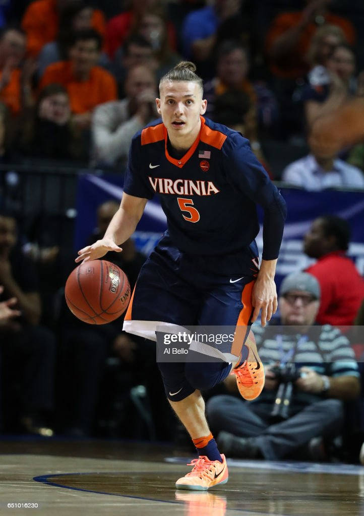 Kyle Guy #5 of the Virginia Cavaliers dribbles upcourt against the Notre Dame Fighting Irish during the Quarterfinals of the ACC Basketball Tournament at the Barclays Center on March 9, 2017 in New York City.