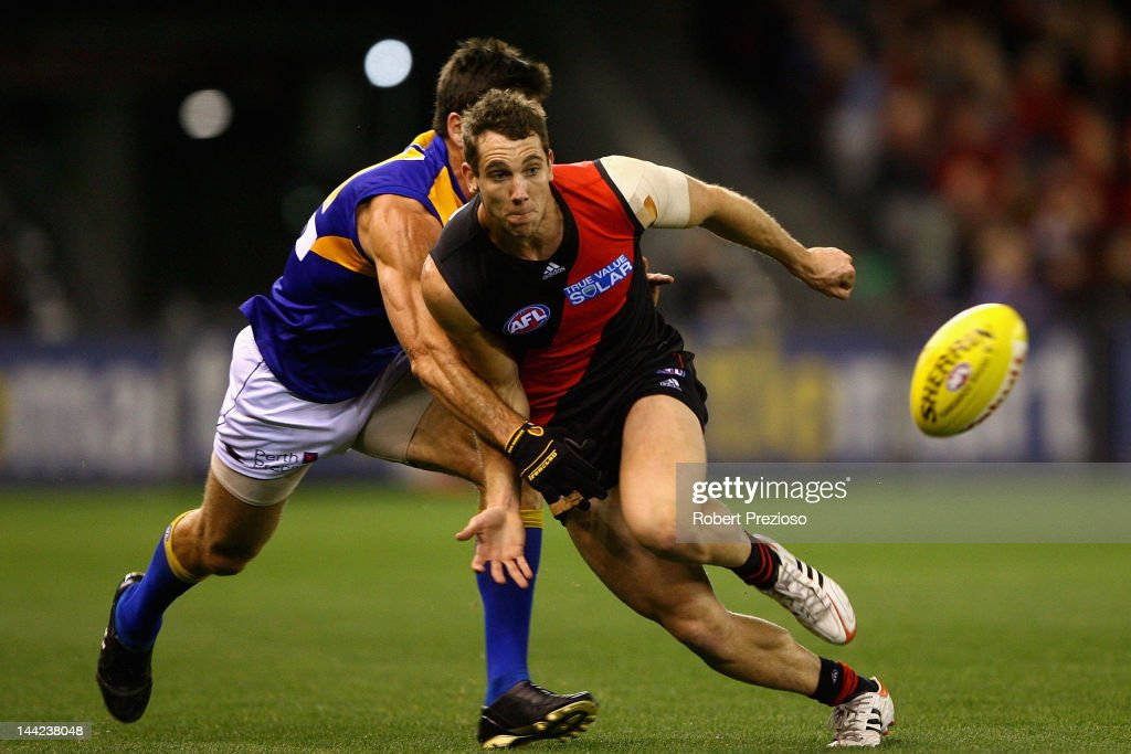 Kyle Hardingham of the Bombers gathers the ball during the round seven AFL match between the Essendon Bombers and the West Coast Eagles at Etihad Stadium on May 12, 2012 in Melbourne, Australia.