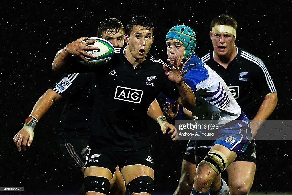 Kyle Harris of New Zealand on the charge against Lewis Carmichael of Scotland during the 2014 Junior World Championship match between New Zealand and Scotland at ECOLight Stadium, Pukekohe on June 10, 2014 in Auckland, New Zealand.