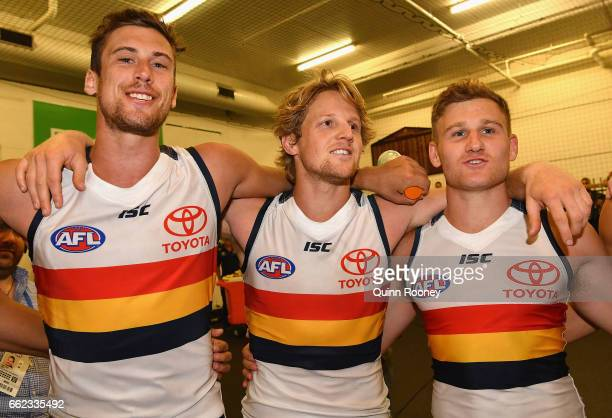 Kyle Hartigan Rory Sloane and Rory Laird of the Crows sing the song after winning the round two AFL match between the Hawthorn Hawks and the Adelaide...