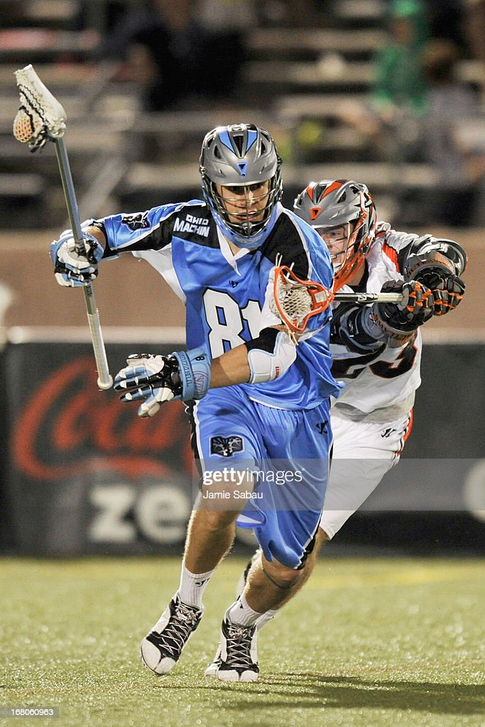 Kyle Hartzell #81 of the Ohio Machine takes control of the ball in the second half as Drew Snider #23 of the Denver Outlaws defends on May 4, 2013 at Selby Stadium in Delaware, Ohio. Denver defeated Ohio 13-8.