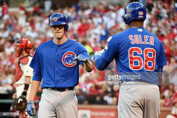 Kyle Hendricks of the Chicago Cubs celebrates with Jorge Soler of the Chicago Cubs after scoring a run in the second inning against the St Louis...