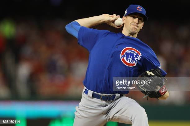 Kyle Hendricks of the Chicago Cubs delivers a pitch against the Washington Nationals in the first inning during game one of the National League...