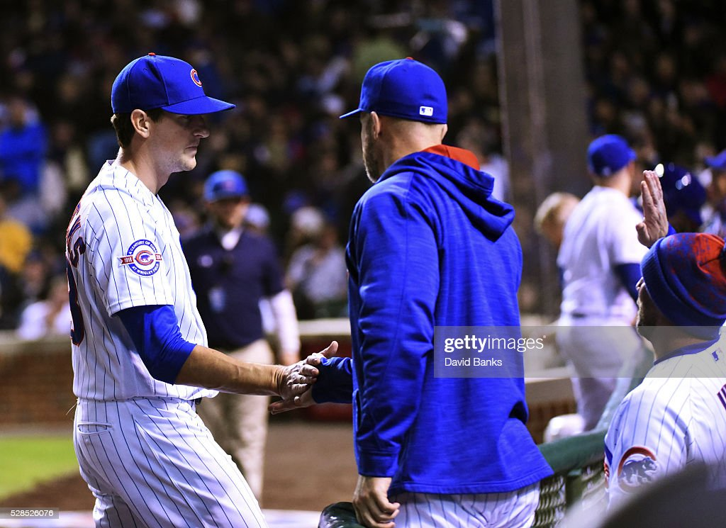 <a gi-track='captionPersonalityLinkClicked' href=/galleries/search?phrase=Kyle+Hendricks&family=editorial&specificpeople=9130544 ng-click='$event.stopPropagation()'>Kyle Hendricks</a> (L) of the Chicago Cubs is greeted by teammates after getting the final out against the Washington Nationals during the sixth inning on May 5, 2016 at Wrigley Field in Chicago, Illinois.