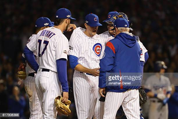 Kyle Hendricks of the Chicago Cubs is relieved in the eighth inning by manager Joe Maddon during game six of the National League Championship Series...