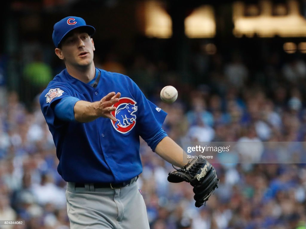 Kyle Hendricks #28 of the Chicago Cubs makes a throw to first base during the second inning of a game against the Milwaukee Brewers at Miller Park on July 29, 2017 in Milwaukee, Wisconsin.