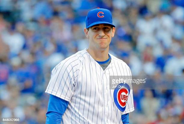 Kyle Hendricks of the Chicago Cubs smirks as he walks off the field after pitching seven scoreless innings against the St Louis Cardinals at Wrigley...