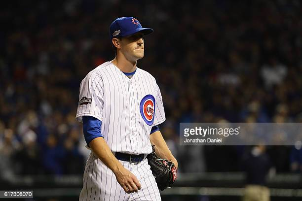 Kyle Hendricks of the Chicago Cubs walks back to the dugout after being relieved in the eighth inning during game six of the National League...
