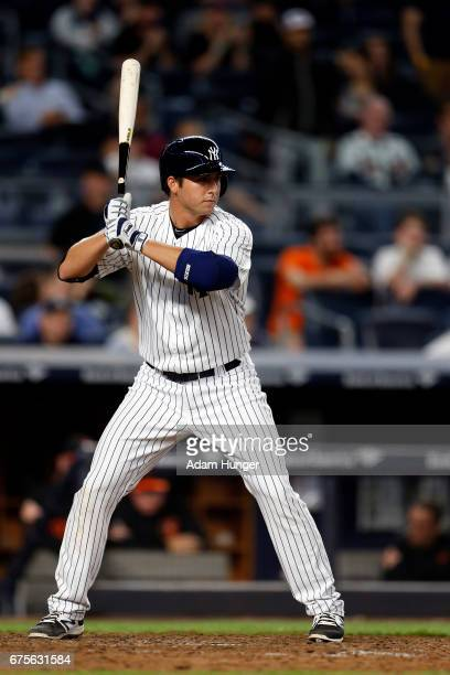 Kyle Higashioka of the New York Yankees at bat against the Baltimore Orioles at Yankee Stadium on April 28 2017 in the Bronx borough of New York City...