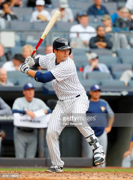 Kyle Higashioka of the New York Yankees bats during an MLB baseball game against the Tampa Bay Rays on April 12 2017 at Yankee Stadium in the Bronx...