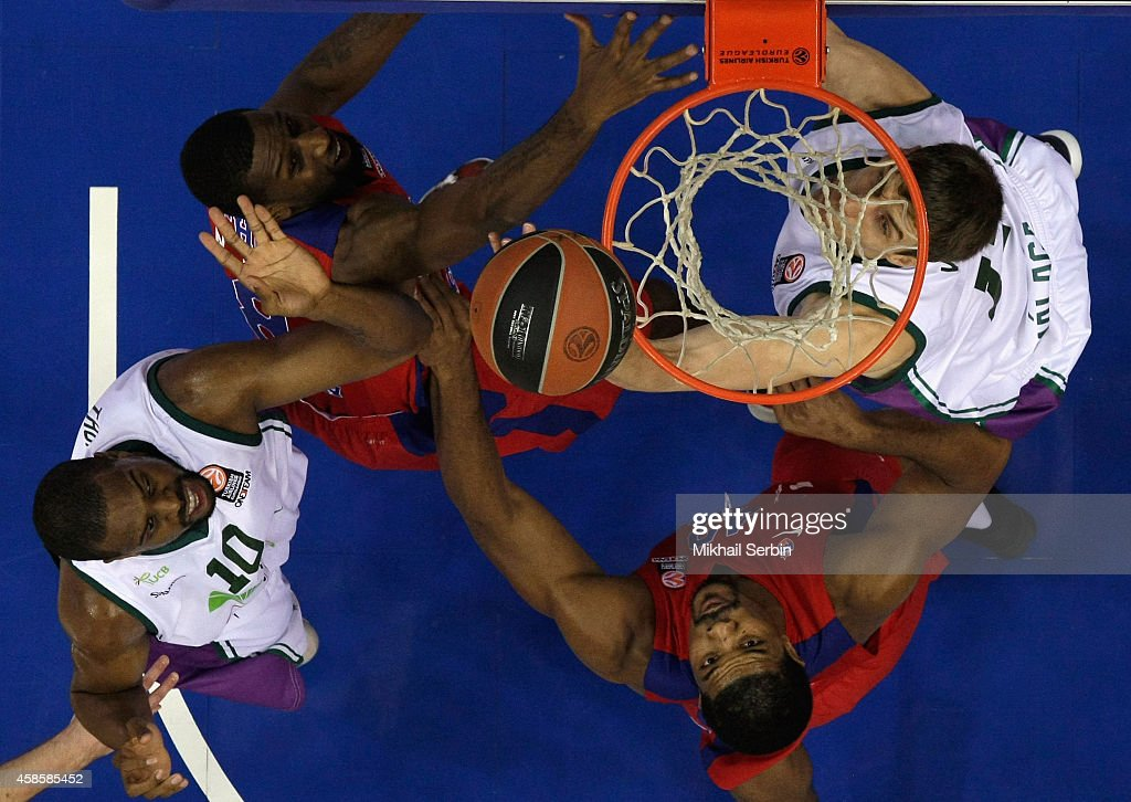 Kyle Hines, #42 and Demetris Nichols, #8 of CSKA Moscow competes with Will Thomas, #10 and <a gi-track='captionPersonalityLinkClicked' href=/galleries/search?phrase=Fran+Vazquez&family=editorial&specificpeople=2236558 ng-click='$event.stopPropagation()'>Fran Vazquez</a>, #17 of Unicaja Malaga in action during the 2014-2015 Turkish Airlines Euroleague Basketball Regular Season Date 4 game between CSKA Moscow v Unicaja Malaga at USH CSKA on November 7, 2014 in Moscow, Russia.