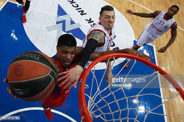 Kyle Hines #42 of CSKA Moscow competes with Daniel Theis #10 of Brose Baskets Bamberg in action during the Turkish Airlines Euroleague Basketball Top...