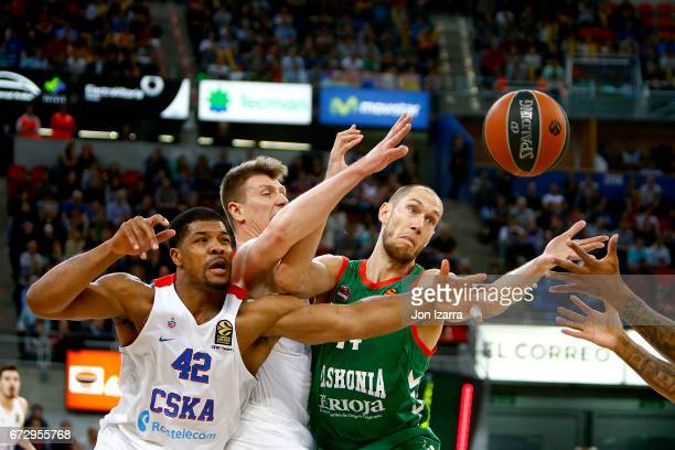 Kyle Hines #42 of CSKA Moscow competes with Kim Tillie #14 of Baskonia Vitoria Gasteiz during the 2016/2017 Turkish Airlines EuroLeague Playoffs leg...