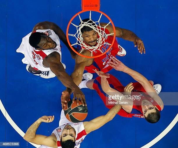 Kyle Hines #42 of CSKA Moscow competes with Othello Hunter #5 of Olympiacos Piraeus in action during the Turkish Airlines Euroleague Basketball Top...