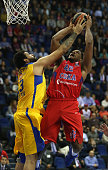 Kyle Hines #42 of CSKA Moscow competes with Vitor Faverani #13 of Maccabi Fox Tel Aviv during the Turkish Airlines Euroleague Basketball Regular...
