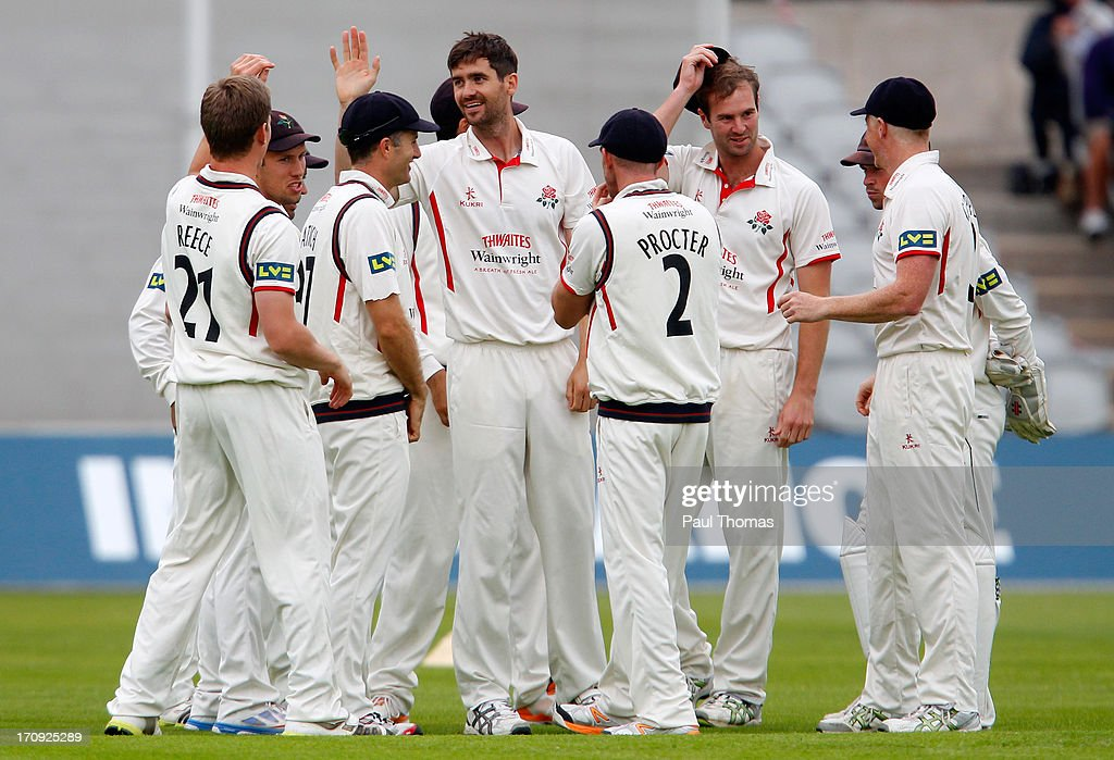 Kyle Hogg (C) of Lancashire celebrates with team mates after taking the wicket of Northants batsman David Sales (not pictured) during day one of the LV County Championship Division Two match between Lancashire and Northamptonshire at Old Trafford on June 20, 2013 in Manchester, England.