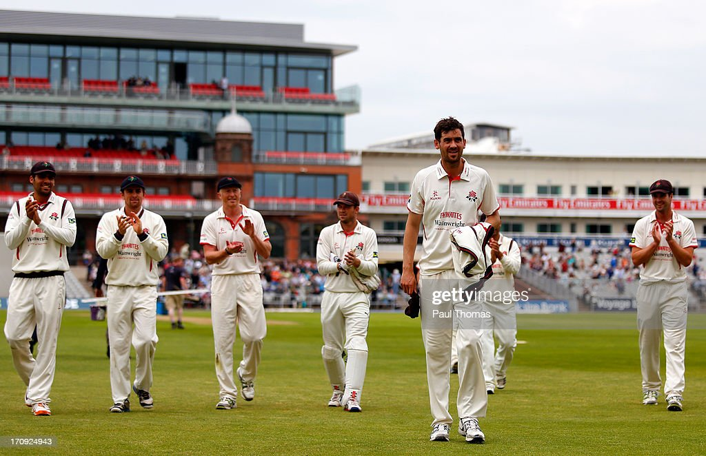 Kyle Hogg (2nd R) of Lancashire is applauded from the field by team mates after taking 7 wickets during day one of the LV County Championship Division Two match between Lancashire and Northamptonshire at Old Trafford on June 20, 2013 in Manchester, England.