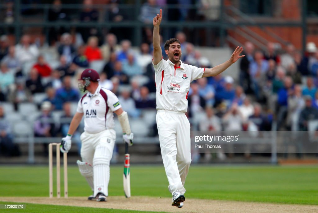 Kyle Hogg (R) of Lancashire successfully appeals for the wicket of David Sales of Northamptonshire during day one of the LV County Championship Division Two match between Lancashire and Northamptonshire at Old Trafford on June 20, 2013 in Manchester, England.
