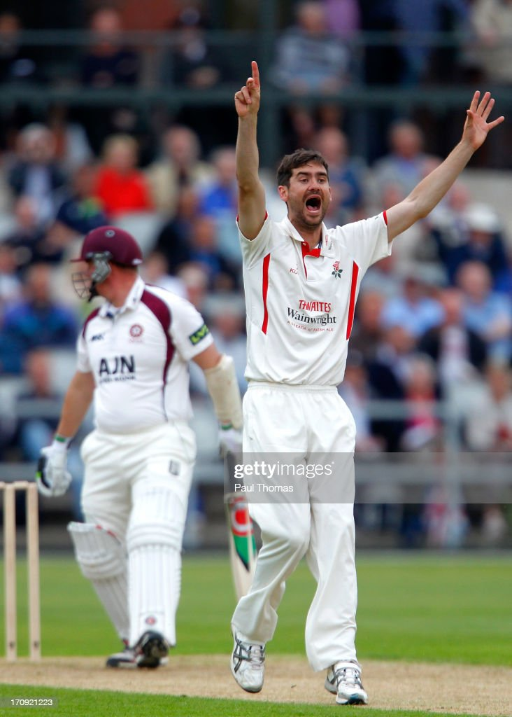 Kyle Hogg (R) of Lancashire successfully appeals for the wicket of Northants batsman David Sales during day one of the LV County Championship Division Two match between Lancashire and Northamptonshire at Old Trafford on June 20, 2013 in Manchester, England.