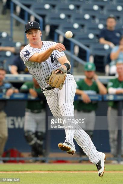 Kyle Holder of the Yankees makes the off balance throw to first base for the out during the Florida State League game between the Daytona Tortugas...