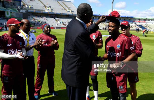 Kyle Hope of the West Indies is presented with his test cap by Joel Garner ahead of the 1st Investec Test match between England and West Indies at...