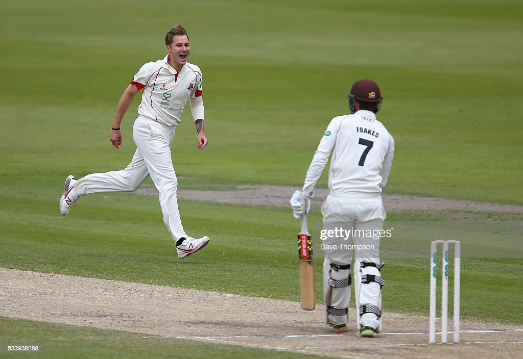 Kyle Jarvis of Lancashire celebrates taking the wicket of <a gi-track='captionPersonalityLinkClicked' href=/galleries/search?phrase=Ben+Foakes&family=editorial&specificpeople=7622687 ng-click='$event.stopPropagation()'>Ben Foakes</a> of Surrey during the Specsavers County Championship Division One match between Lancashire and Surrey at The Emirates Old Trafford Cricket Ground on May 24, 2016 in Manchester, England.