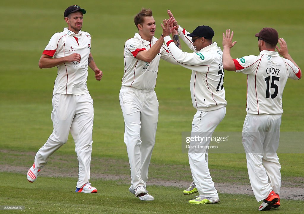 Kyle Jarvis of Lancashire celebrates taking the wicket of Ben Foakes of Surrey during the Specsavers County Championship Division One match between Lancashire and Surrey at The Emirates Old Trafford Cricket Ground on May 24, 2016 in Manchester, England.