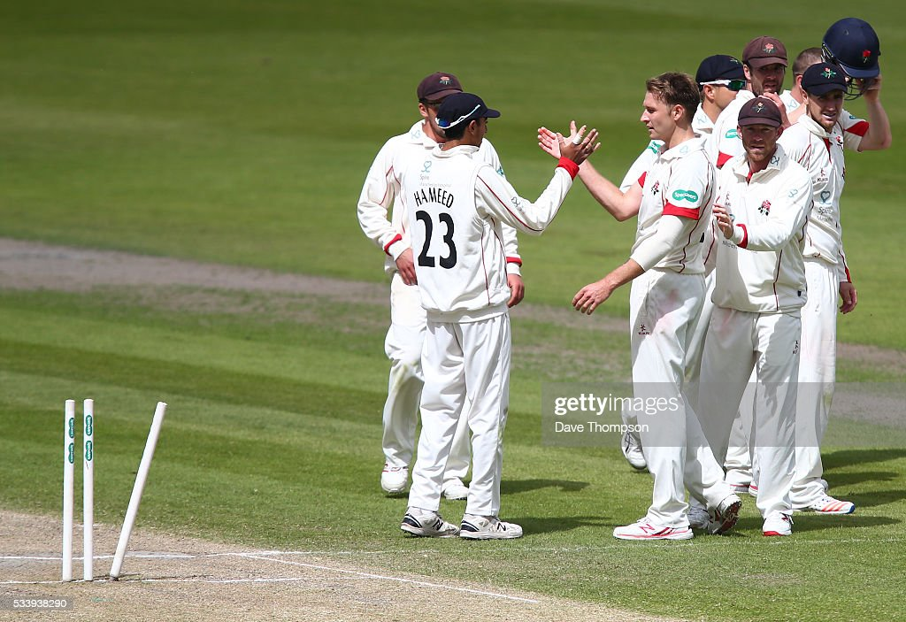 Kyle Jarvis of Lancashire (centre right) celebrates taking the wicket of Gareth Batty of Surrey during the Specsavers County Championship Division One match between Lancashire and Surrey at The Emirates Old Trafford Cricket Ground on May 24, 2016 in Manchester, England.