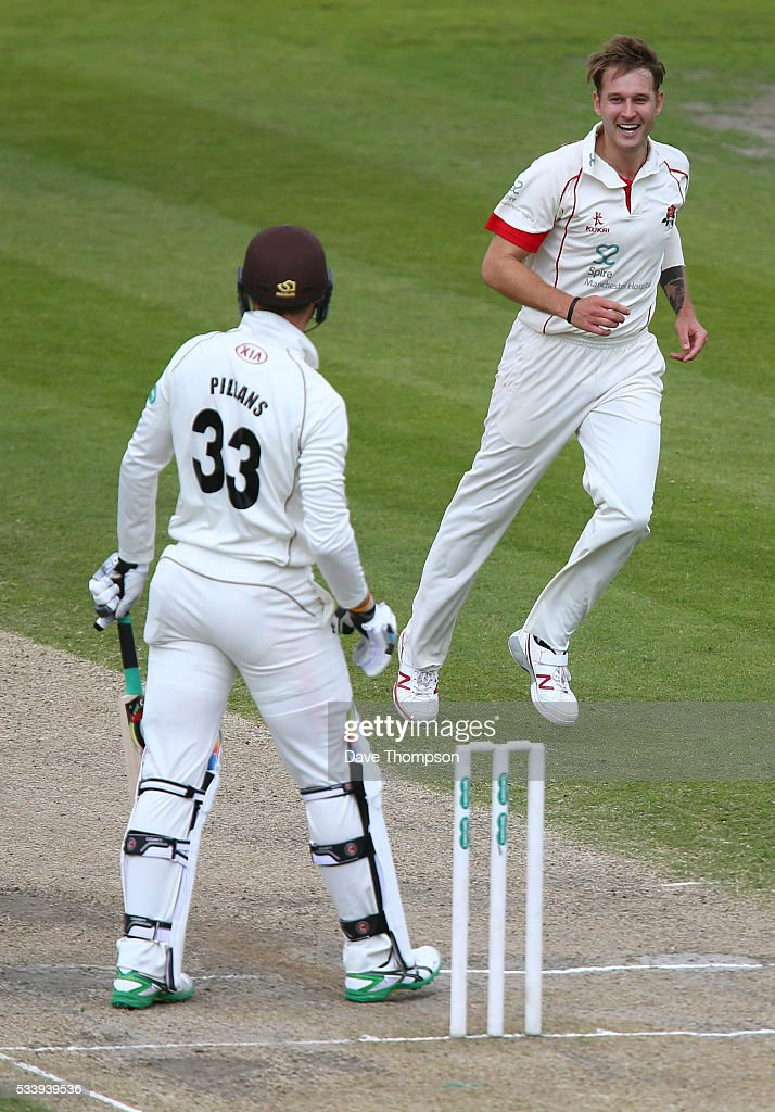 Kyle Jarvis of Lancashire celebrates taking the wicket of Mathew Pillans of Surrey during the Specsavers County Championship Division One match between Lancashire and Surrey at The Emirates Old Trafford Cricket Ground on May 24, 2016 in Manchester, England.