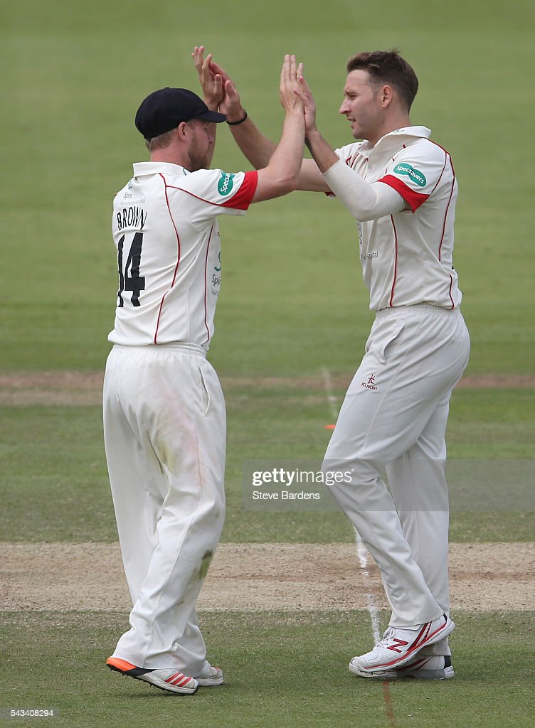 Kyle Jarvis of Lancashire (R) celebrates taking the wicket of Stephen Eskanazi of Middlesex with his team mate Karl Brown during day three of the Specsavers County Championship division one match between Middlesex and Lancashire at Lords on June 28, 2016 in London, England.
