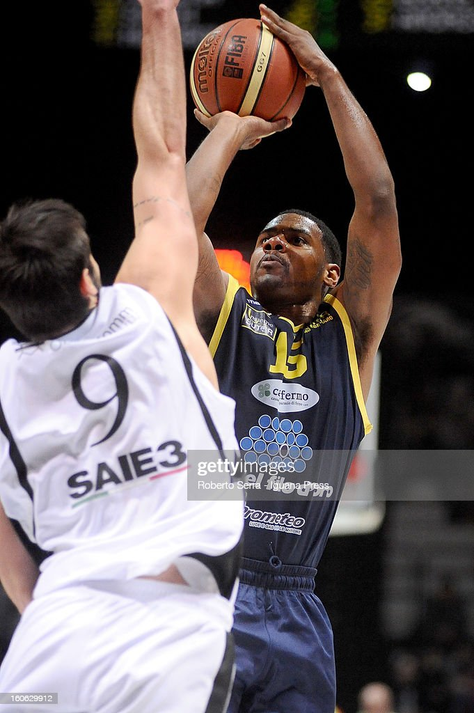 Kyle Johnson of Sutor competes with Riccardo Moraschini of SAIE3 during the LegaBasket Serie A match between Virtus Bologna SAIE3 and Sutor Montegranaro at Unipol Arena on February 3, 2013 in Bologna, Italy.