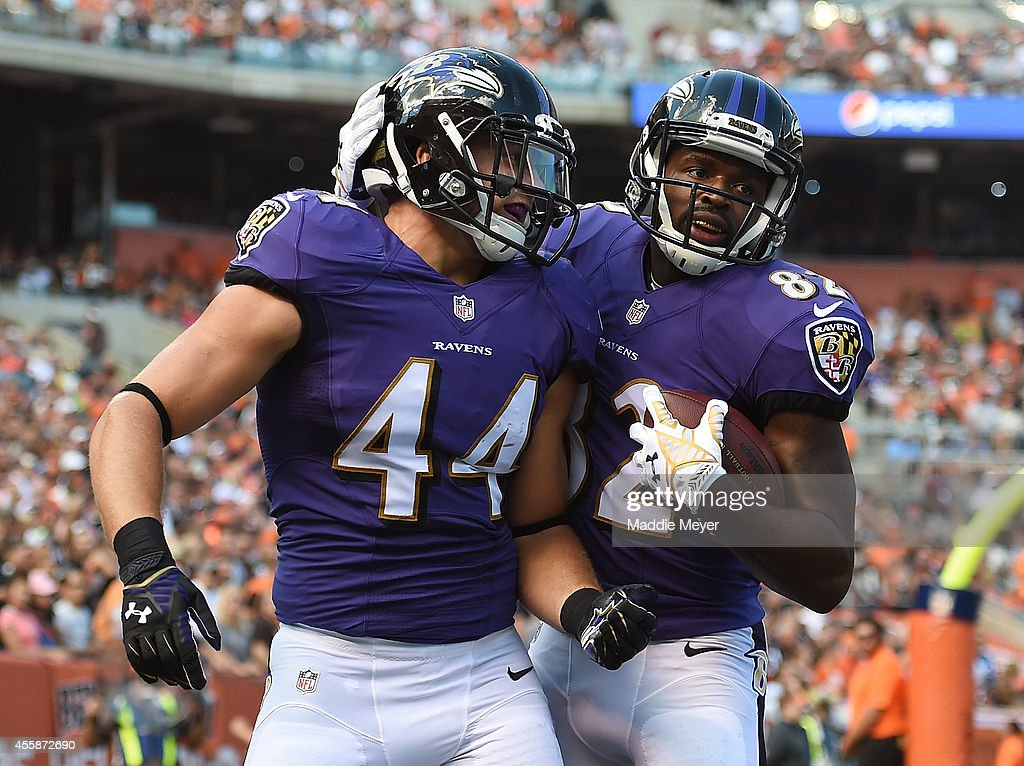 <a gi-track='captionPersonalityLinkClicked' href=/galleries/search?phrase=Kyle+Juszczyk&family=editorial&specificpeople=8661738 ng-click='$event.stopPropagation()'>Kyle Juszczyk</a> #44 celebrates his second quarter touchdown with <a gi-track='captionPersonalityLinkClicked' href=/galleries/search?phrase=Torrey+Smith&family=editorial&specificpeople=5527843 ng-click='$event.stopPropagation()'>Torrey Smith</a> #82 of the Baltimore Ravens against the Cleveland Browns at FirstEnergy Stadium on September 21, 2014 in Cleveland, Ohio.