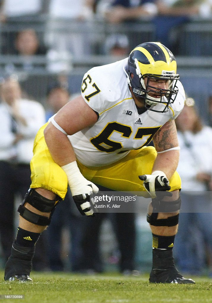 Kyle Kalis #67 of the Michigan Wolverines plays against the Penn State Nittany Lions during the game on October 12, 2013 at Beaver Stadium in State College, Pennsylvania.