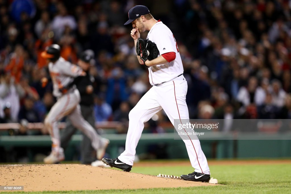 Kyle Kendrick #25 of the Boston Red Sox reacts after Manny Machado #13 of the Baltimore Orioles hit a three-run homer during the fourth inning at Fenway Park on May 4, 2017 in Boston, Massachusetts.