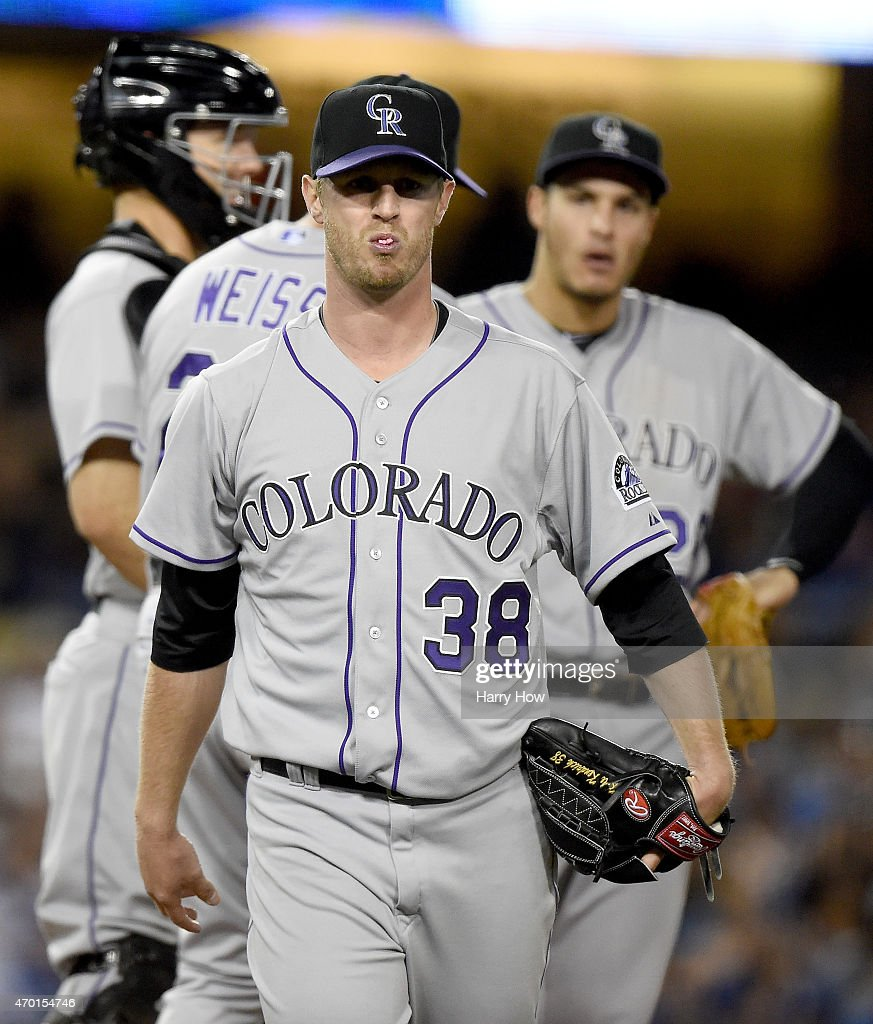 Kyle Kendrick #38 of the Colorado Rockies leaves the game in the fifth inning trailing 6-3 to the Los Angeles Dodgers at Dodger Stadium on April 17, 2015 in Los Angeles, California.