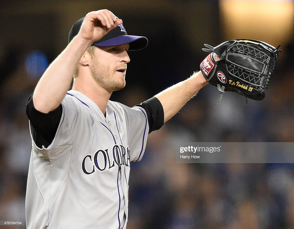 Kyle Kendrick #38 of the Colorado Rockies reacts after an Adrian Gonzalez #23 of the Los Angeles Dodgers run to take a 6-3 lead during the fifth inning at Dodger Stadium on April 17, 2015 in Los Angeles, California.