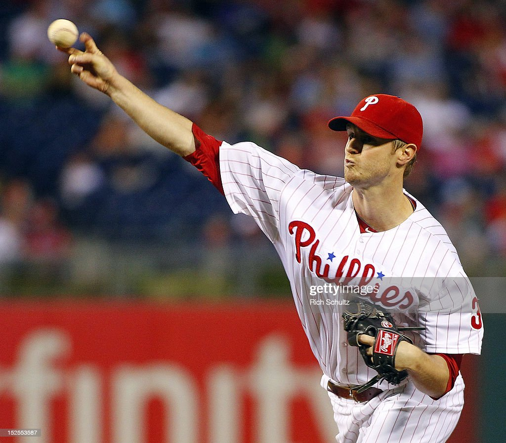 <a gi-track='captionPersonalityLinkClicked' href=/galleries/search?phrase=Kyle+Kendrick&family=editorial&specificpeople=4365300 ng-click='$event.stopPropagation()'>Kyle Kendrick</a> #38 of the Philadelphia Phillies delivers a pitch against the Atlanta Braves in the first inning during a game on September 21, 2012 at Citizens Bank Park in Philadelphia, Pennsylvania.