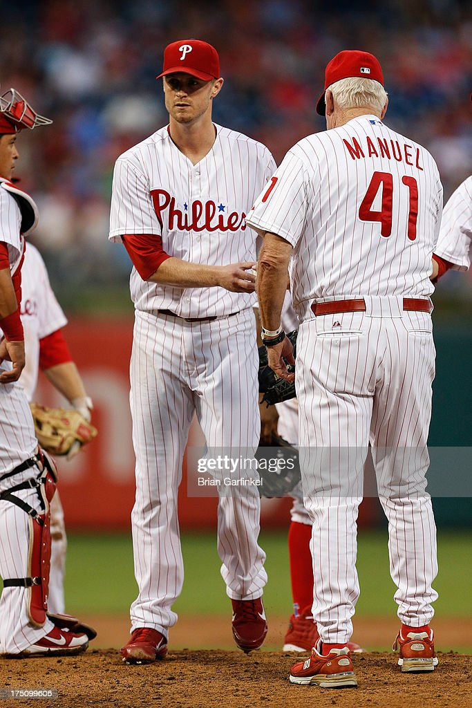 <a gi-track='captionPersonalityLinkClicked' href=/galleries/search?phrase=Kyle+Kendrick&family=editorial&specificpeople=4365300 ng-click='$event.stopPropagation()'>Kyle Kendrick</a> #38 of the Philadelphia Phillies is pulled in the third inning of the game against the San Francisco Giants at Citizens Bank Park on July 31, 2013 in Philadelphia, Pennsylvania.