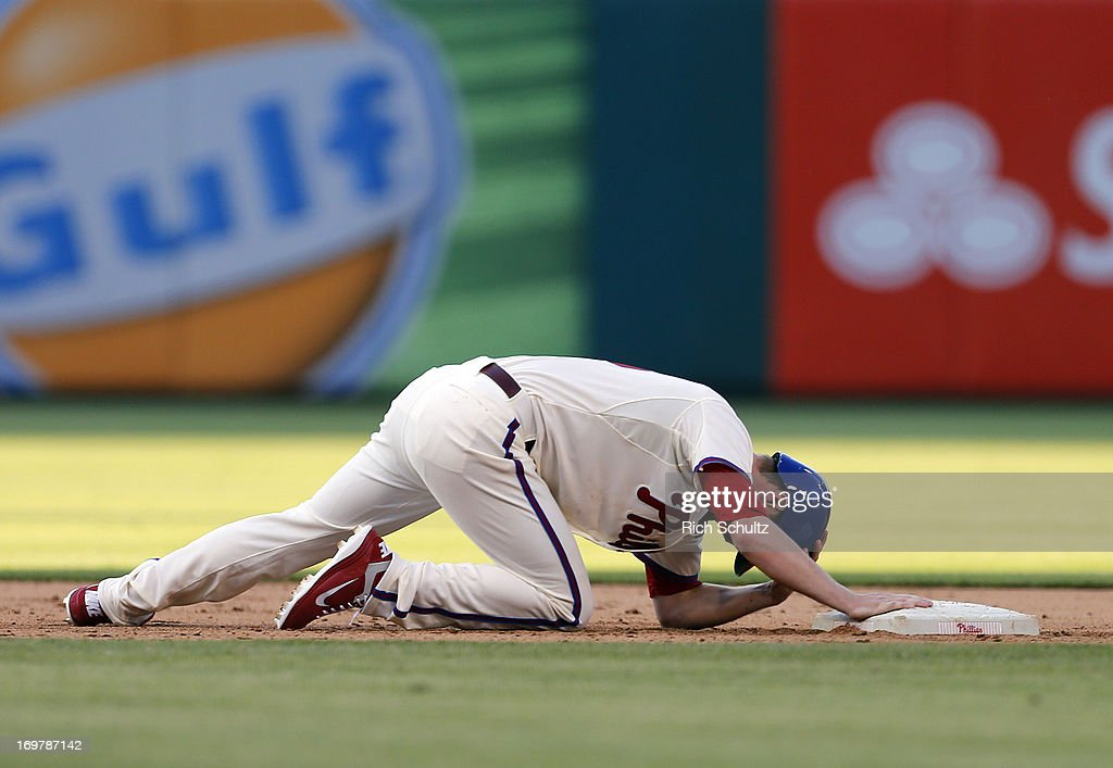 <a gi-track='captionPersonalityLinkClicked' href=/galleries/search?phrase=Kyle+Kendrick&family=editorial&specificpeople=4365300 ng-click='$event.stopPropagation()'>Kyle Kendrick</a> #38 of the Philadelphia Phillies reacts after getting picked off second base while pinch running during the ninth inning against the Milwaukee Brewers in a MLB baseball game on June 1, 2013 at Citizens Bank Park in Philadelphia, Pennsylvania.